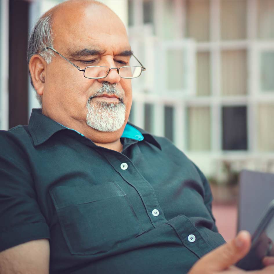A man looking at his mobile phone