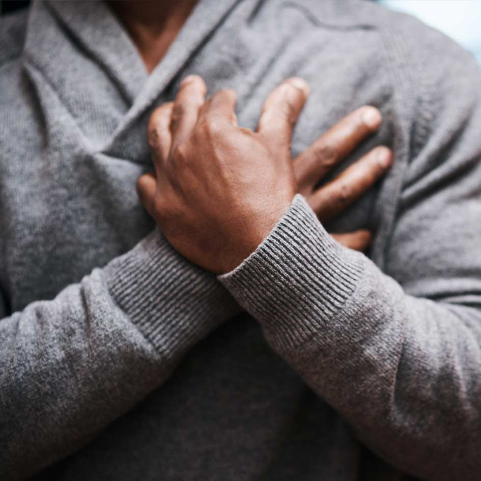 A man clutching his heart
