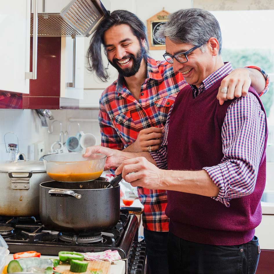 A father and son cooking together